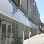 New retail storefronts at the street level in the existing parking structure.