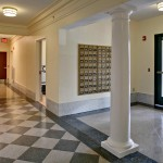 Restored hallway with mail room connection to new lobby