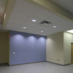 The receptionist and check in area (unfurnished). Wheelchair storage is to the right.